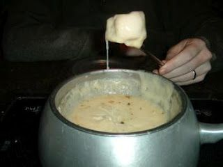 The Melting Pot's Garlic & Herb Cheese Fondue, prepared with Green Goddess Sauce