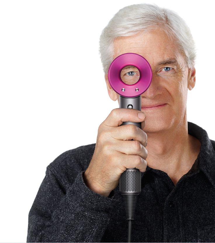 James Dyson holding the Dyson Supersoni™ hair dryer