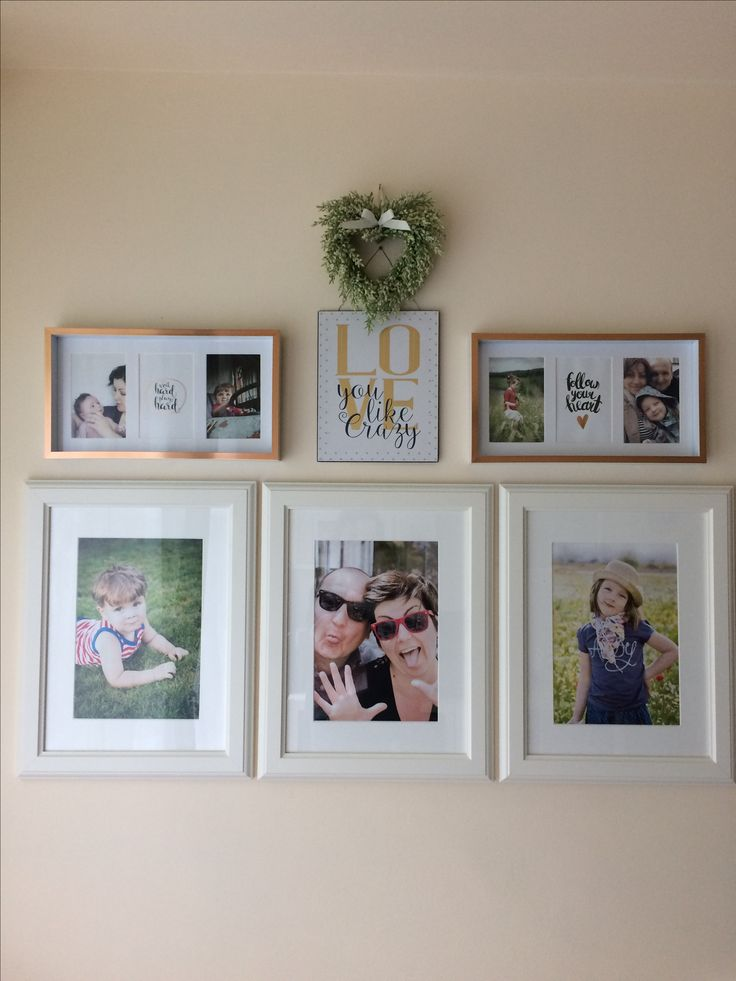 Arranging family pictures on the wall..