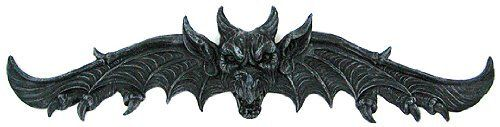Gothic Gargoyle Door Pediment Plaque Demon Evil by Private Label. $29.99. This awesomely scary gargoyle door topper is the perfect accessory for a Gothic themed room. Made of cold cast resin, it can be used indoors or outdoors. The pediment measures 9 inches tall, 34 inches wide, and juts out 3 1/2 inches from the wall. The detailing is incredible, with the gargoyle's face appearing to be bursting through the wings.This door topper makes a great housewarming gift...
