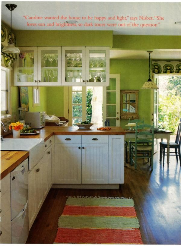 Green and white kitchen bright and happy with warm tones for Kitchen cabinets green
