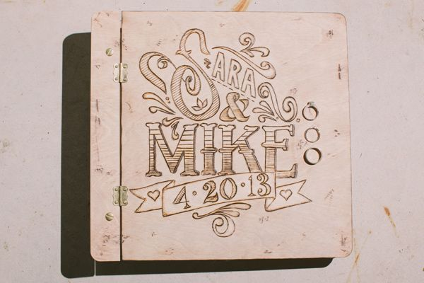 wood-burned wedding guest book // photo by Julia of Our Labor of Love
