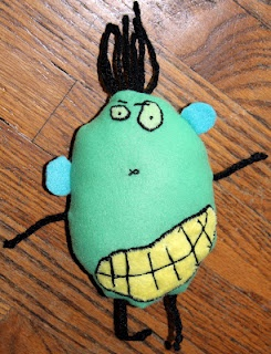 stuffed toy monster from child's drawing