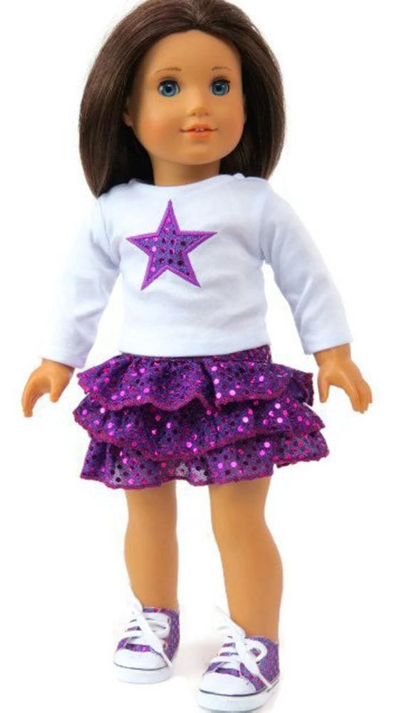 "White Top with Star & Purple Sequined Ruffled Skirt. White long sleeved top with star and purple sequined ruffled skirt. For more clothes, shoes, and accessories for 18"" American Girl dolls. The doll and shoes shown are for modeling purposes only and are not included. 