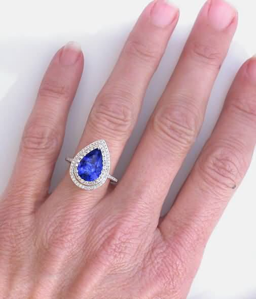 Tanzanite engagement ring, only way to protect that center stone. Beautiful and brittle. Make sure to use a bezel setting or many prongs in the design. Too expensive to replace too often. Protect it!