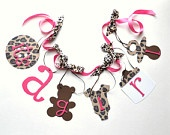 Cheetah baby shower decorations leopard it's a girl banner by ParkersPrints on Etsy. $16.50, via Etsy.