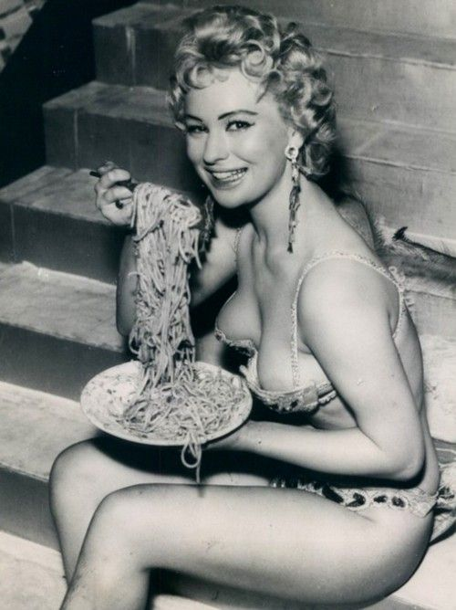 Italian Vintage Photographs ~  Italian Girls know how to eat spaghetti and still manage to look sexy.