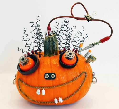 This is probably the coolest Halloween pumpkin I've seen so far. Junk-o-lantern is much more creative than traditional carved pumpkins. To make similar jack-o-lantern you'll need a bunch of old hardware, nails, screws, nuts, bolts, fasteners, springs, electrical stuff, clamps and wire. Raid your junk storage for all these stuff. For more details and full tutorial visit smallhandsbigart.