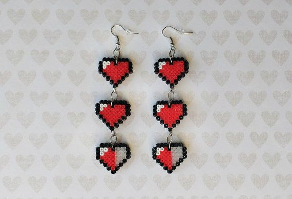 Add life to your outfit with these Zelda life heart earrings! ;) These adorable handmade hearts are eye-catching with just the right amount of geeky. Theyre lightweight, and swing and sway as you walk. MADE TO ORDER! Your choice of hook wire or clip-on.  ■ this listing is for a pair of earrings (quantity 1 means 1 pair) ■ light-weight: approx 3 grams per earring ■ approx 20mm across, 4mm thick, 100mm tall ■ water-resistant ■ hypoallergenic and nickel-free ■ rubber backs or stoppers included…