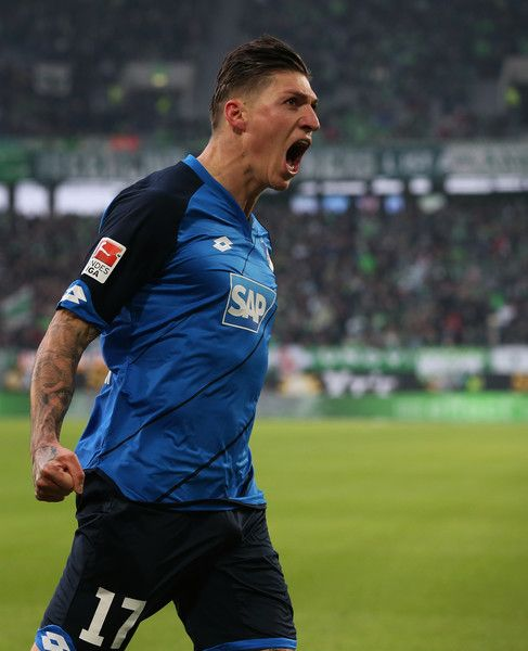 Hoffenheim's Swiss midfielder Steven Zuber celebrates after scoring his team's opening goal during the German First division Bundesliga football match between VfL Wolfsburg v TSG Hoffenheim 1899 in Wolfsburg, on February 12, 2017. / AFP / Ronny Hartmann / RESTRICTIONS: DURING MATCH TIME: DFL RULES TO LIMIT THE ONLINE USAGE TO 15 PICTURES PER MATCH AND FORBID IMAGE SEQUENCES TO SIMULATE VIDEO. == RESTRICTED TO EDITORIAL USE == FOR FURTHER QUERIES PLEASE CONTACT DFL DIRECTLY AT + 49 69 650050.