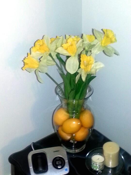 Lemon vase with daffodils
