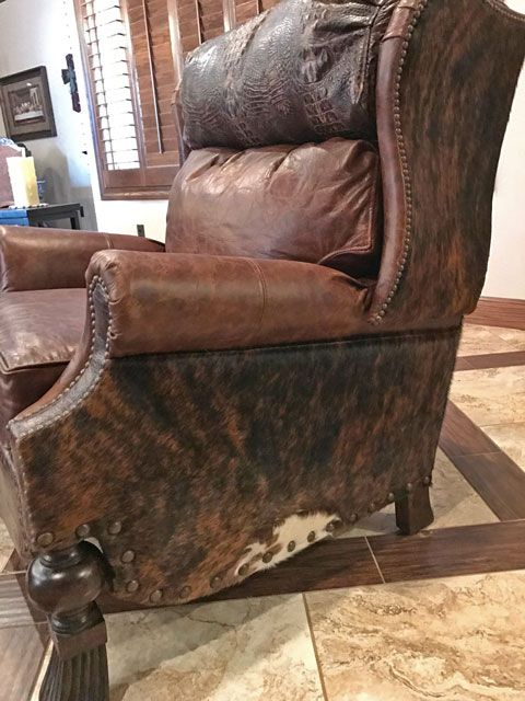 Next best thing to riding a bull, but still able to relax and recline. This Bronco Recliner is made with a solid hardwood frame for durability. It features leather and cowhide upholstery for a rustic look and comfortable chair overall. Cowhide will vary slightly. This chair can be customized with various types of leather, cowhide, fabrics, or any combination. Call for more details. The price listed is for the featured photo. The dimensions are: 36W x 42D x 45H. Allow 8-10 weeks for delivery…