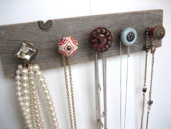 Add different handles/drawer pulls to a piece of wood to make a necklace holder.