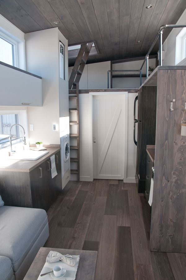 Inside the Sakura is heated vinyl flooring, white pine walls, and a stained ceiling. The bedroom is located above the gooseneck, allowing for significantly more headroom than a traditional loft.