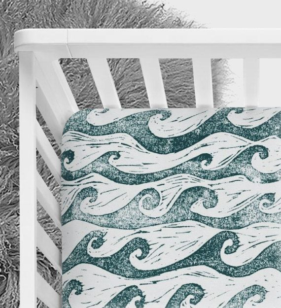 Waves upon the sea .... come away with me! This sheet fits a standard crib mattress (28 x 52). All corner seams are serged for a professional and durable finish. Weve also encased quality elastic around the entire edge of the sheet for a snug and safe fit.  We have taken special care of this fabric by pre-washing and pre-drying to prevent fading and shrinkage. We recommend a gentle machine wash in cold water, with a low heat dryer setting.  Made with love for you in a clean and smoke free…
