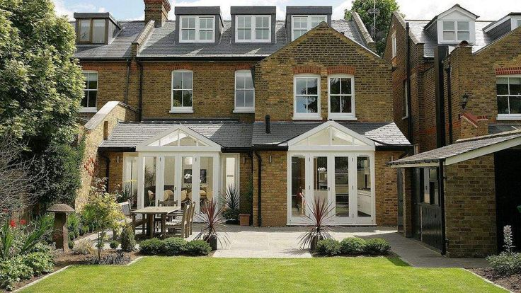Twin garden room extensions on a london victorian terrace for Pinterest garden rooms
