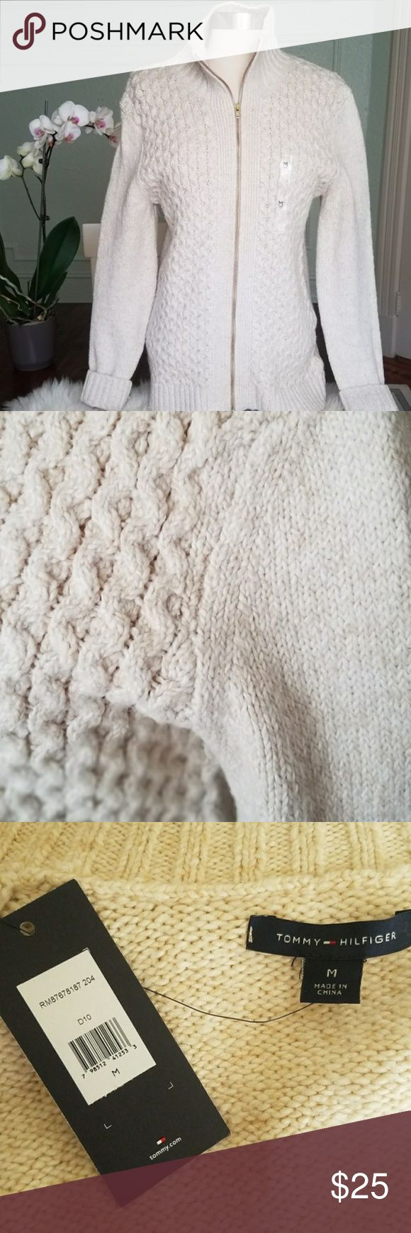 Tommy Hill figure beige zip-up sweater nwt. Tommy Hill figure beige zip-up sweater nwt. Gold zipper Knitted sleeves with intricate knitted front. Tommy Hilfiger Sweaters