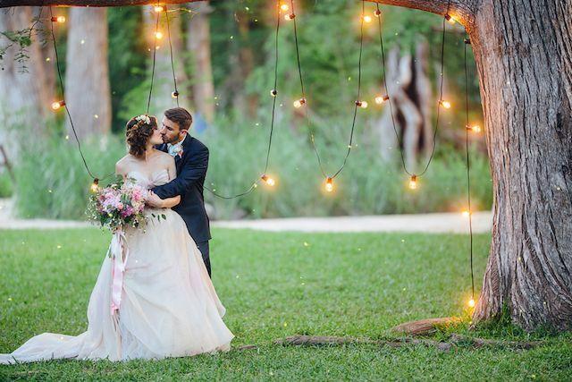 Bistro lights backdrop wedding ceremony | Christina Carroll Photography