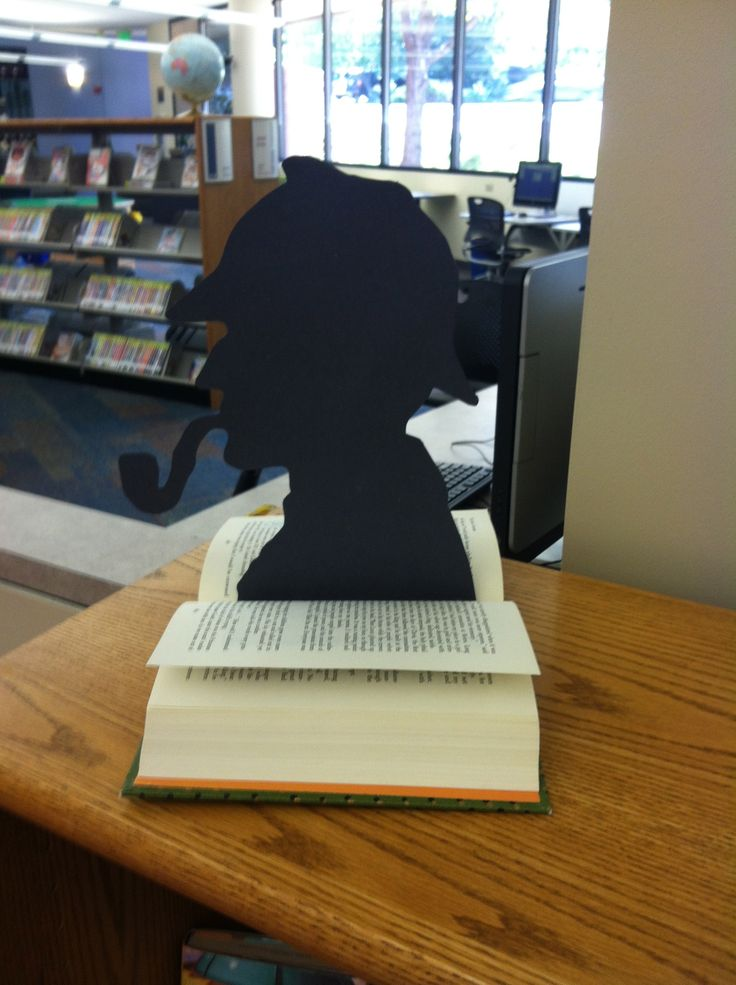 """Mystery Fiction Library Display Sherlock holmes silhouette, """"bleeding"""" book, caution tape, murder victim outline"""