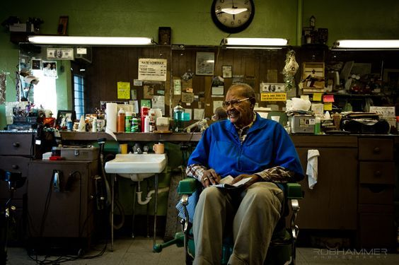 """Imperial Barber Shop, Omaha, Nebraska. Owner Charles Smith, aka Uncle Charlie, sets a spell. (Rob Hammer photo from his 2014 book """"Barbershops of America"""". Rob notes: """"On the outskirts of Omaha is on old neighborhood. If you drive down 24th Street, you'll have no problem finding a barber. There is a bunch on new blood, and a couple of real shops that seem like they opened their doors before any houses were even built around them. Imperial Barber Shop is one of them."""")"""