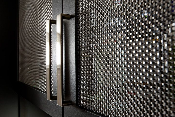 Metal grill doors provide airflow to home theatre equipment and creates a modern look for cabinets.