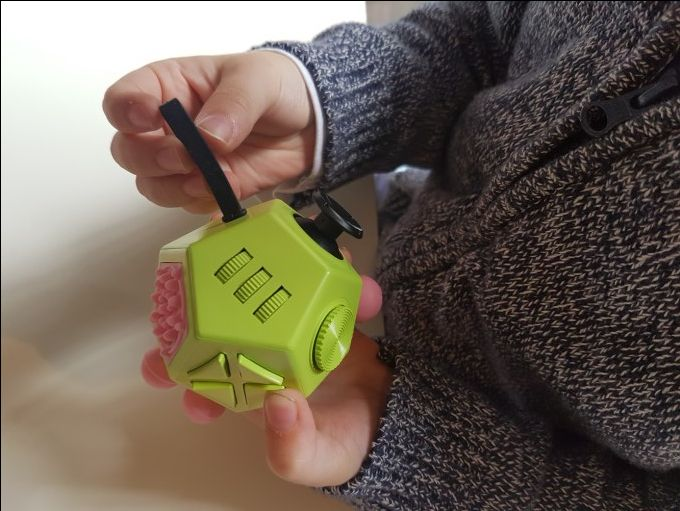 12 sided fidget cube, autism fidget toy, reduce anxiety, stop nail biting, reduce fidgeting, and support students with autism and learning difficulties