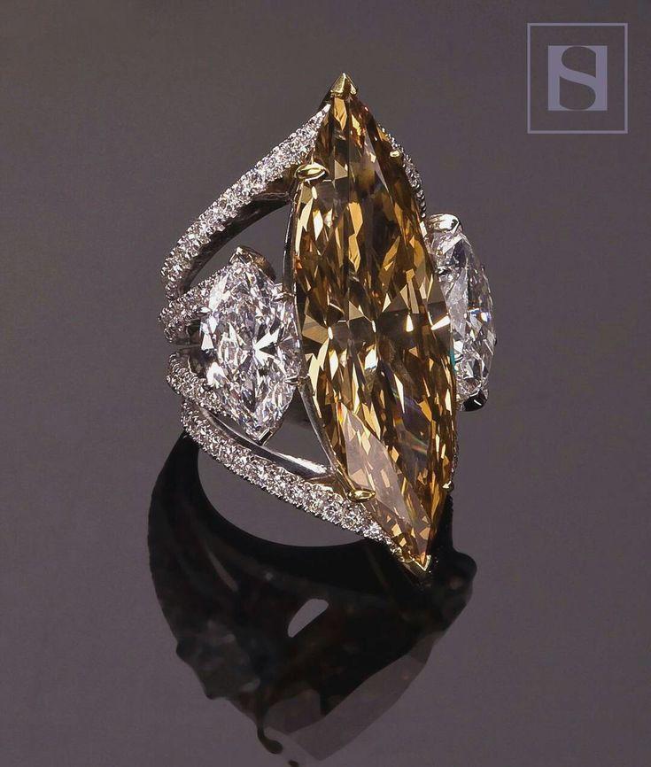 32 carat champagne diamond , 3 carats white diamonds
