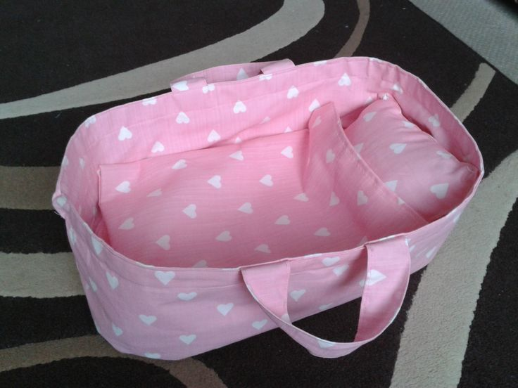Baby doll moses basket style carry cot bed with blanket and pillow.    I followed the tutorial herehttp://juniberry.blogspot.co.uk/2008/04/dolls-basket-tutorial.html and added a matching blanket and pillow.