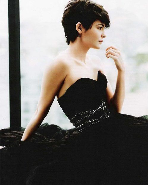 short hair, heavy in front.  I loved having short hair. As an adult I think it totally fits my Gamine qualities. Plus I love this black dress..... so elegantly french