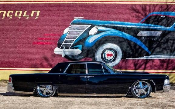 lincoln continental suicide doors and a gloss black paint job on five spoke wheels vehicles. Black Bedroom Furniture Sets. Home Design Ideas