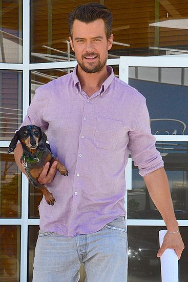 Mans Best Friend: Josh Duhamel proved that dogs make great accessories while he walked around LA on Friday.