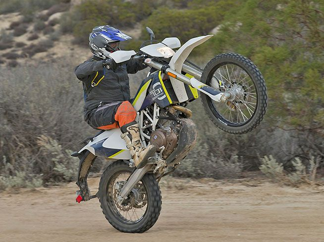 Husqvarna's new 701 Enduro cranks out so much low-end torque that lofting the front wheel is easy. The 701 is an extremely versatile and fun dual-sport machine.