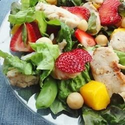 A delightful spinach salad with strawberries, snap peas and chicken is topped off with an outstanding homemade poppy seed dressing.