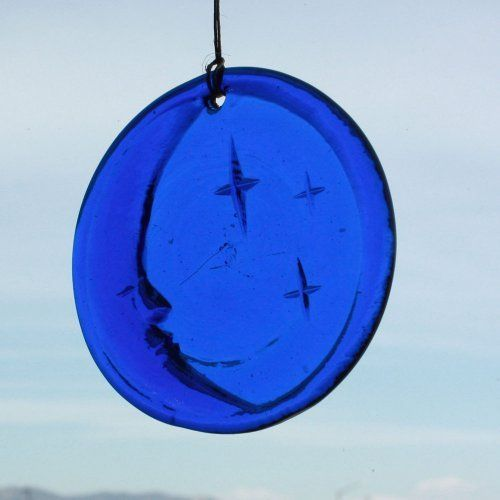 "Peaceful Night Window Suncatcher in Cobalt - Hanging Glass - 4.25 in Diameter - Made From Recycled Glass by The Glass reFactory. $12.65. Reflect the simple beauty of the night with the moon and stars in this cobalt ""Peaceful Night"" suncatcher.  A unique, sparkly, and beautiful gift that says you care about conserving resources.  These colorful suncatchers with nature inspired designs are made from 100% recycled bottles collected at a non-profit recyclin..."