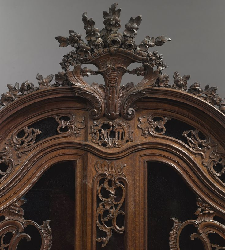 c1750 A Louis XV carved oak display cabinet Aachen or Liège, circa 1750 Estimate  7,000 — 10,000  USD  LOT SOLD. 50,000 USD (Hammer Price with Buyer's Premium)