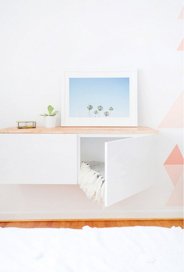 By hanging IKEA's Bestå shelf unit on the wall and topping it with a stained panel of wood, one decorating created a floated credenza that looks way more costly than it is.- 16 Astoundingly Chic IKEA Hacks via @domainehome