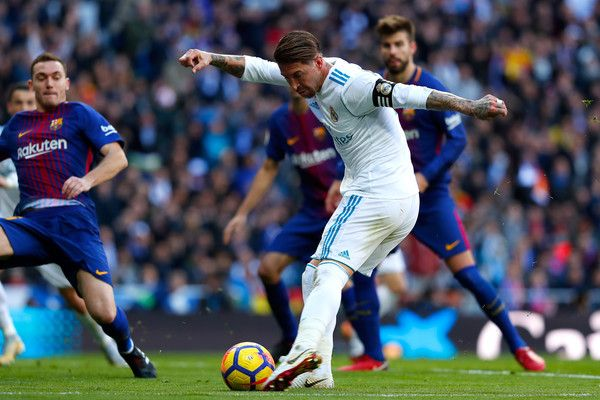 Sergio Ramos of Real Madrid shoots during the La Liga match between Real Madrid and Barcelona at Estadio Santiago Bernabeu on December 23, 2017 in Madrid, Spain.
