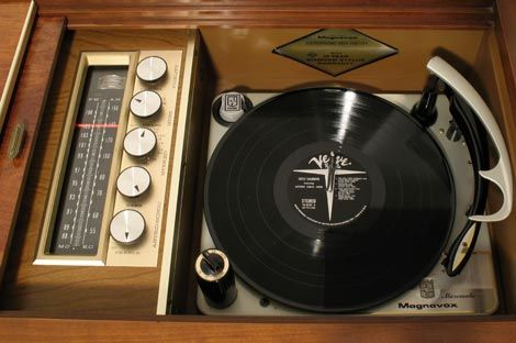 Stereo consoles with radio & record players.