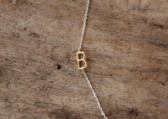 A delicate golden letter.