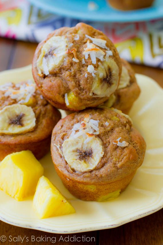 Skinny, Bikini-Friendly Tropical Muffins. Made with bananas, pineapple, orange zest, yogurt, whole wheat flour, and coconut. Easy, moist, low-fat, healthy muffins | sallysbakingaddiction.com