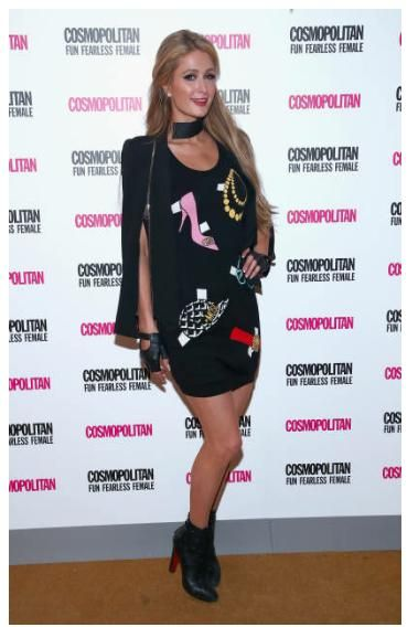 Paris Hilton wearing Christian Louboutin Lamu Boots, Tiffany & Co. Platinum Diamond Stud Earrings, Chanel Black Leather Fingerless Gloves, Forever Unique Becca Cape Jacket Zip Detail and Moschino Sleeveless Printed Dress