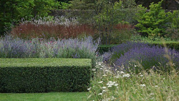 Dan Pearson with strong contrast using blocks of box and ornamental grasses