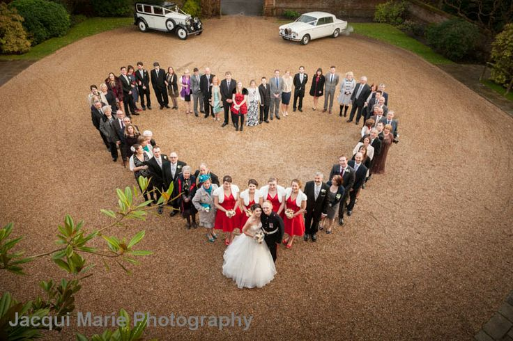 Stunning heart shaped group shot at New Place, Hampshire - an amazing wedding venue. Photographed by affordable Hampshire wedding photographers Jacqui Marie Photography. VISIT http://jacqui-marie-photography.co.uk for details