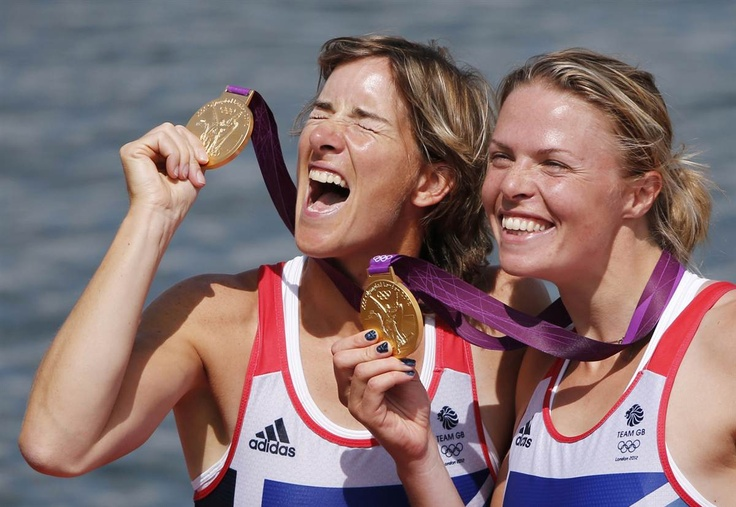 Great Britain's Katherine Grainger, left, and Anna Watkins display their gold medals from the women's rowing double sculls.