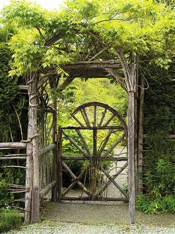 keeping the rustic sensibility with the entire construction: gate, fencing, arbor, overhead trellis