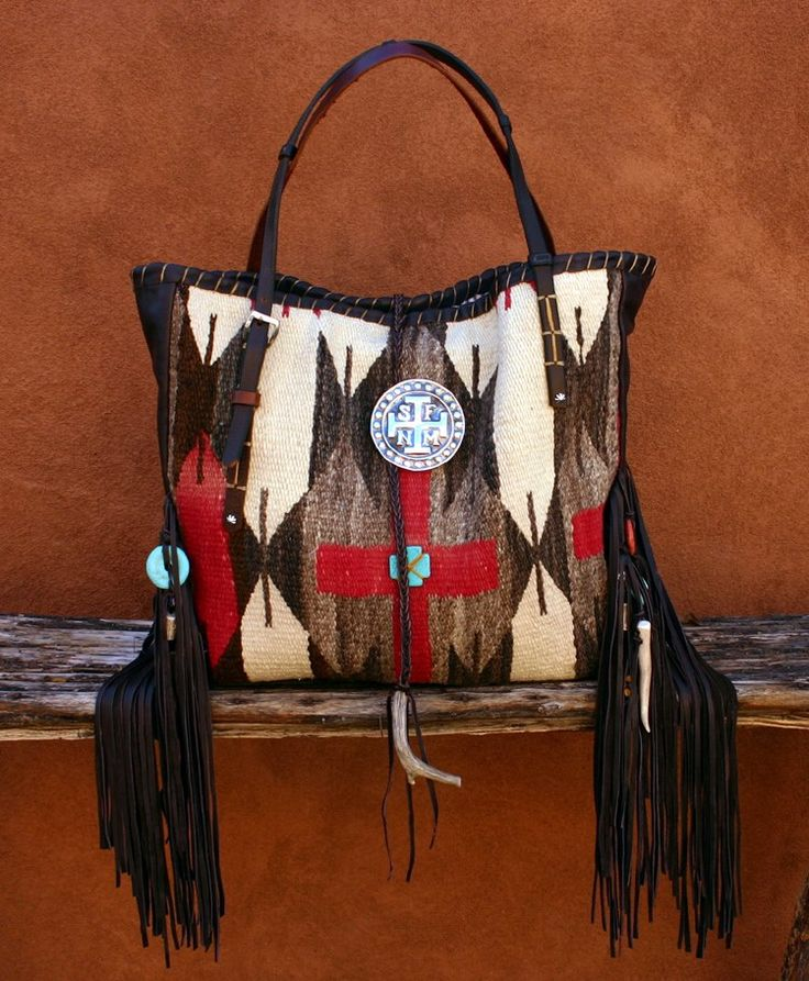 THE ORY : Navajo Handbags made from blankets / rugs, vintage horse tack, and deer, elk or cowhide leathers. I embellish the bags with vintage trade beads, turquoise, coral, nickel silver/German silver Concho buttons, nickel silver spots/studs, and deer antler tips.