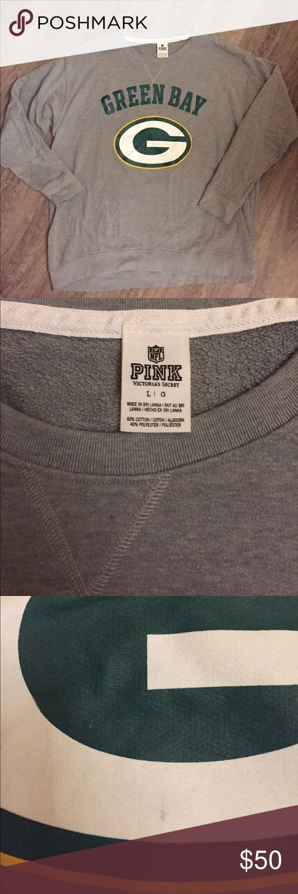VS PINK NFL Green Bay Packers sweatshirt RARE Victoria's Secret PINK NFL Collection Green Bay Packers sweatshirt. Size large- runs on the larger side. Extremely soft and comfortable. No pilling and looks like it's never been worn, aside from a small mark on the Packers logo. Hard to find! PINK Victoria's Secret Sweaters Crew & Scoop Necks