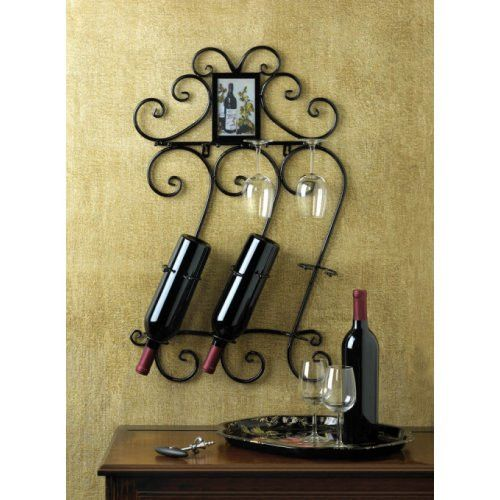 Be prepared for a celebration when you have three bottles of wine and four wine glasses mounted to your wall with this pretty Wrought Iron Scrollwork Wine Bottle And Glass Wall Mount Display Rack. Add your favorite portrait at top.