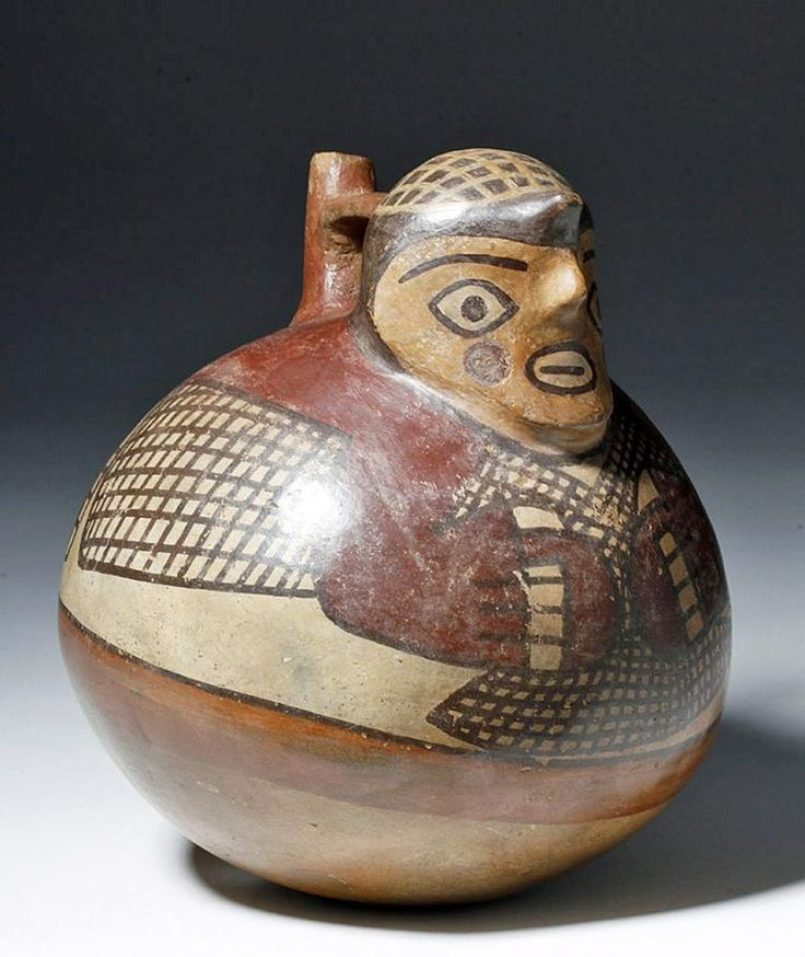 Pre-Columbian, Southern Peru, Nazca, Ca. 200 to 600 CE. A large, polychrome bridge-spout, round-bottomed vessel decorated in the form of a fisherman with a  modeled face emerging from the front, the visage comprised of wide, open eyes, arching brows, a horizontal, full-lipped smile, and ruddy circular cheeks, all topped by a netted cap over his protruding coiffure.  He holds a fisherman's net in both hands that wraps around his body which is whimsically spread over the upper portion of t...