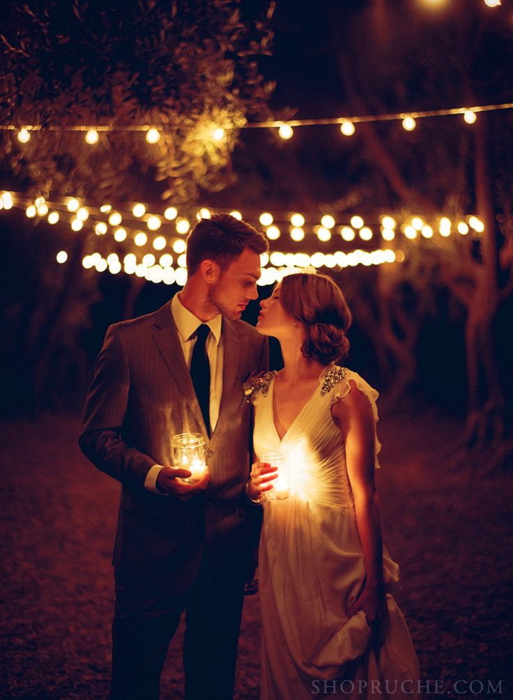 Romantic low lit candle photo of the bride and groom